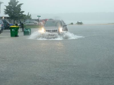 A street in Dewey Beach floods in a steady rain in July 2013. (File Picture)