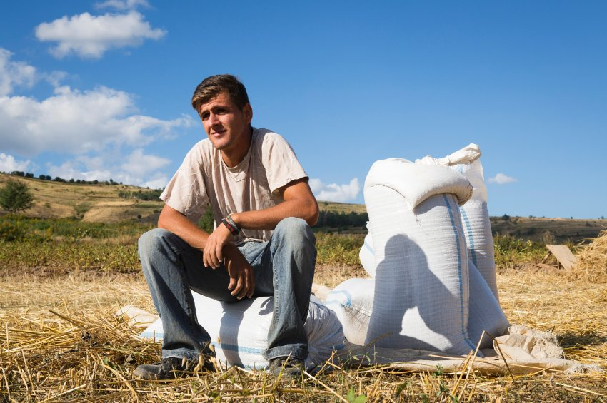 Mali Tafaj, 23, works on the farm with his family near the village of Novosej, Albania. As his parents age Mali Tafaj says he feels a sense of responsibility to step up and care for the family and has considered moving to the EU to work.