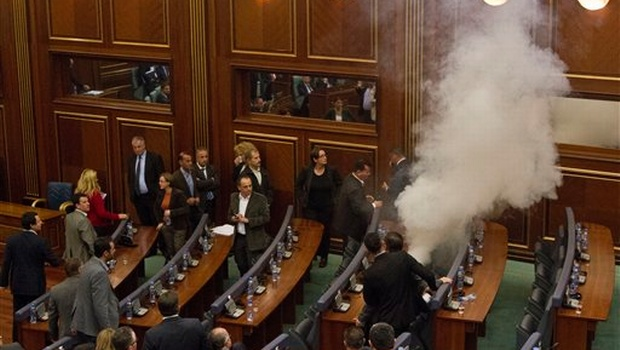 Smoke covers the chamber of parliament as opposition lawmakers in Kosovo disrupt Parliament's session using tear gas, in capital Pristina on Friday| Photo: AP
